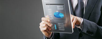 Financial Planning:businessman using a digital tablet